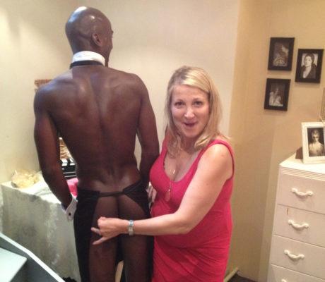 Blonde girl touching butler's bum