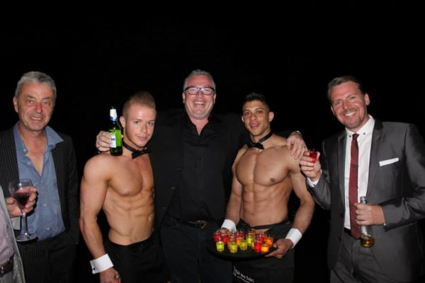 Butler posing with some male guests